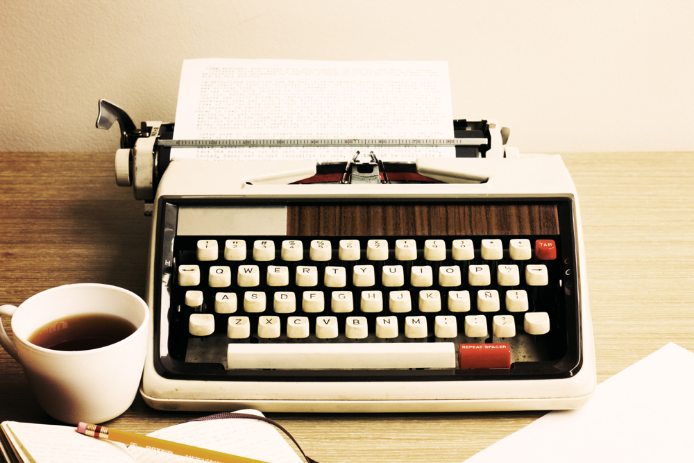 vintage-typewriter-and-coffee-cup.jpg